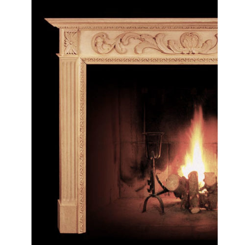 Fluting rises up from the base blocks of the fireplace mantels to the rectangular rosettes with intricate flowers