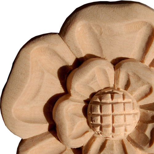Bowie wood rosettes are carved in a deep relief with flower motif